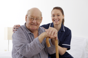 caregiver with elderly patient at the nursing home